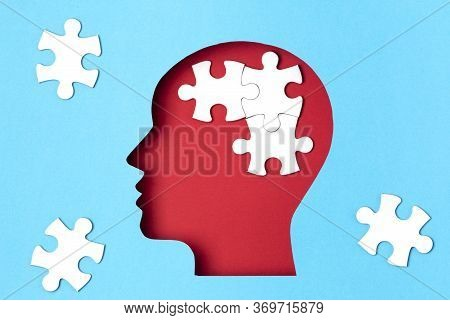 Papercut Head With Jigsaw Puzzle Pieces Inside. Mental Health Problems, Psychology, Memory, Logic, T