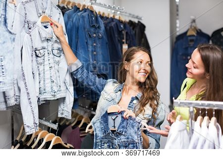 Smiling Woman Selecting A Waistcoat In Commercial Centre