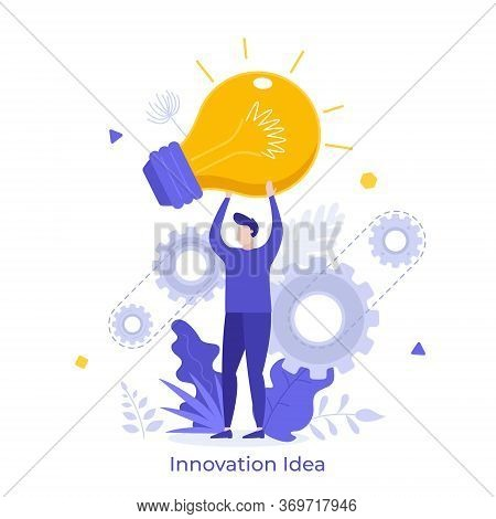 Man Holding Giant Glowing Electric Light Bulb. Concept Of Innovative Idea, Innovation, Breakthrough