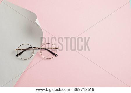 Stylish Eyeglasses Over Pastel  Background. Optical Store, Glasses Selection, Eye Test, Vision Exami