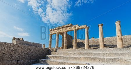 Beautiful View Of Ancient Magnificent Greek Pillars Of The Lindos Acropolis Rhodes.