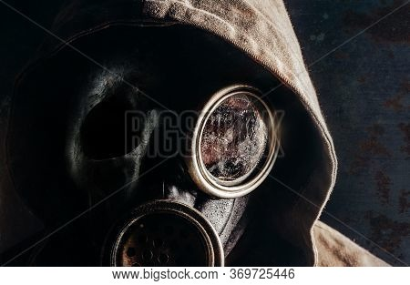 Photo Of A Stalker Man In Soviet Gas Mask And Skull Face Closeup View.