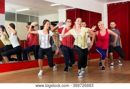 Happy Caucasian People Dancing In A Sports Hall On A Choreography Lesson