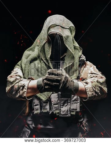 Photo Of A Fully Equipped Camouflaged Soldier In Tectical Net Scarf With Tactical Vest And Gloves Ho