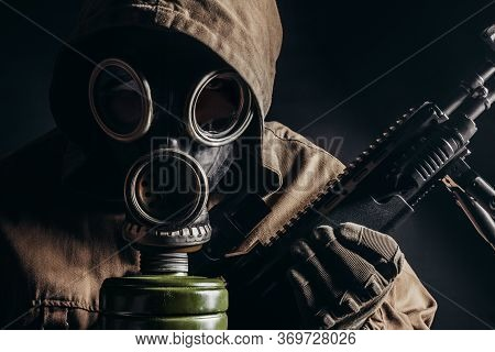Photo Of A Stalker Man In Soviet Gas Mask Holding Sniper Rifle Closeup View.