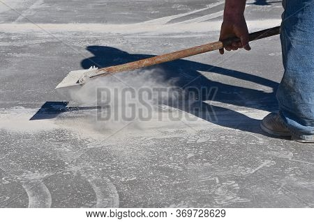 A Layer Of Dust Is Removed After Cutting Through Concrete In The Creation Of Expansion Joints On A S