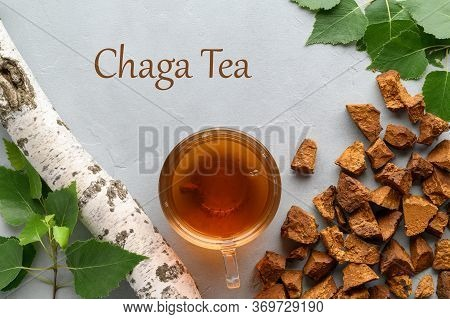 Slicing Chaga Mushrooms And Tea In A Glass Cup On A Light Gray Concrete Background. Trendy Healthy B