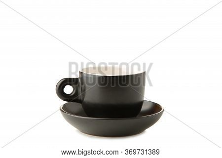 Black Cup And Saucer Isolated On White Background. Top View