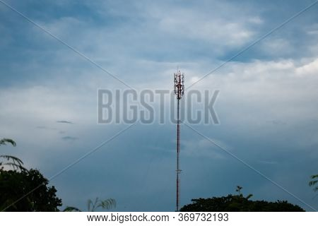 Telephone Antena Green Field And Blue Sky With White Clouds