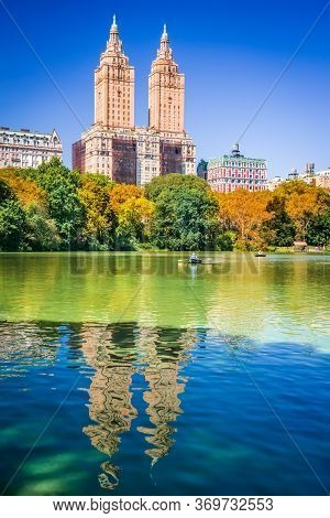 Central Park Autumn And Buildings Reflection In Midtown Manhattan New York City, United States Of Am