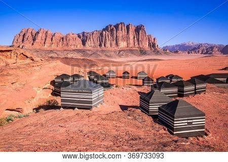 Wadi Rum, Jordan. Valley Of The Moon With El Qattar Mountain And Bedouin Camp World Wonder In Arabia