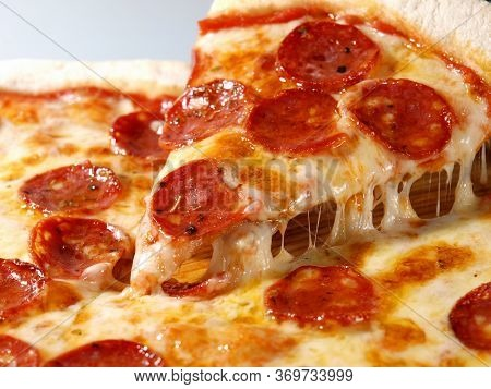 Pepperoni Pizza. Slice Of Pizza With Cheese. Italian Cuisine