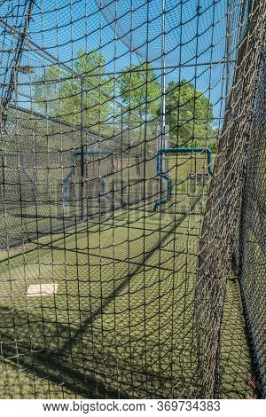 Empty And Vacant Batting Cages At A Baseball Field In A Park Closed Due To The Covid-19 Pandemic In