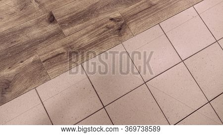 Floor Of Two Materials. Diagonal Transition Of Wood Laminate And Ceramic Tile.