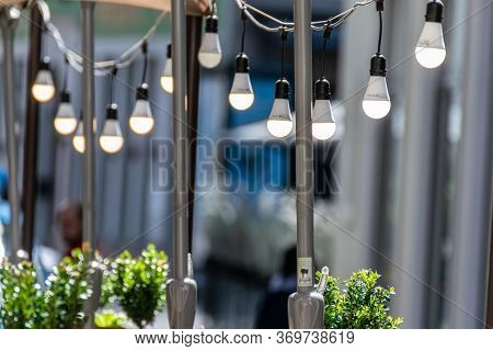 Modern Led Lamps On A Wire. Outdoor Restaurant Lighting. Simple Lighting Decor.