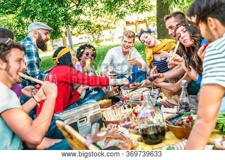 Happy Friends Having Fun Outdoor Eating Snack And Drinking Red Wine At Bbq Picnic - Young Multiracia