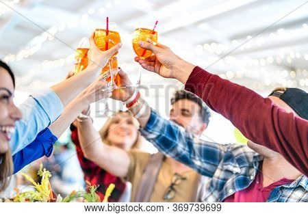 People Toasting Spritz Drink At Fashion Cocktail Bar Restaurant - Lifestyle Concept With Young Frien
