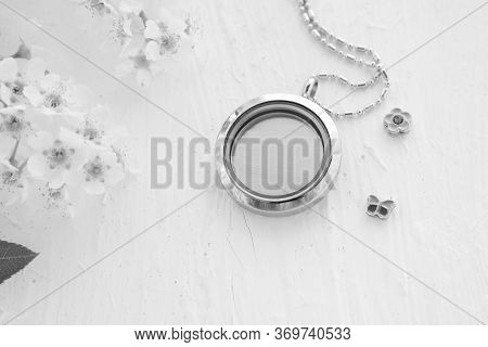 Silver Necklace For Her Shining On White With White Flowers. Luxury Silver Jewelry Chains With Glass