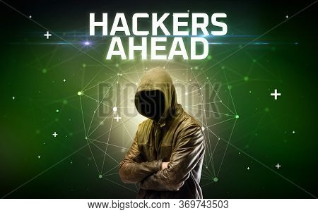 Mysterious hacker with HACKERS AHEAD inscription, online attack concept inscription, online security concept