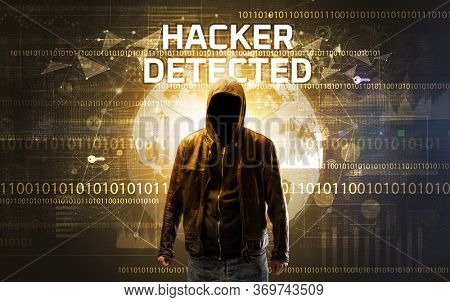 Faceless hacker at work with HACKER DETECTED inscription, Computer security concept