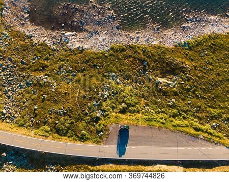 Top Down View. Camper Car On Road, Hardangervidda Mountain Plateau, Norway Landscape. National Touri