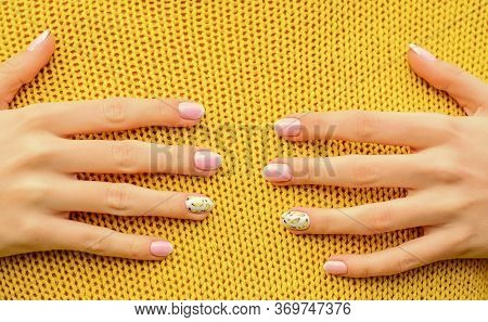 Hug Concept. Beautiful Hands Touching Knitted Background. Spa And Nail Care. Healthy Nails. Nail Art