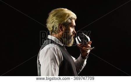 Elegant Macho Drink Cognac. Matured In Sherry Casks. Whisky Tasting. Sommelier Tastes Expensive Drin