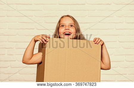 Move To New House. Rent Concept. Repair Annd Relocate. Happy Childhood. Copy Space. Small Girl Child