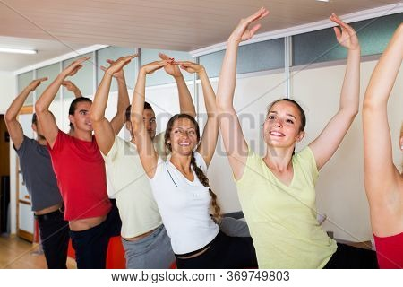 Group Of Happy Russian Men And Women Practicing At The Ballet Barre