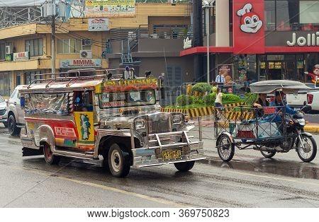Cebu City, Philippines - October 1, 2018: Traffic On Street Cebu City At The Philippines In Rainy Da