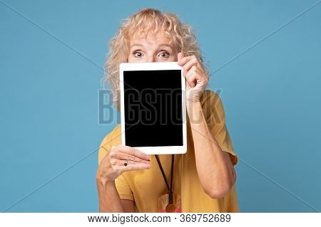 Blonde Senior Caucasian Woman Showing Empty Tablet Screen.