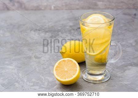 Refreshing Lemon Drink On The Table. Alternative Medicine, Treatment With Folk Remedies.