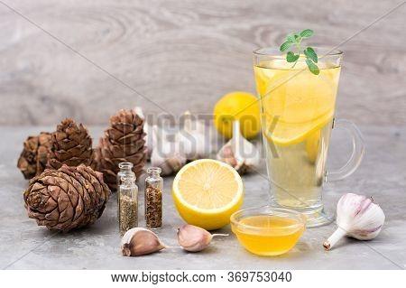 Set Of Natural Antiviral Agents: Lemon, Garlic, Honey, Herbs, Cedar Resin On The Table. Alternative