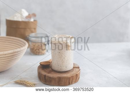 Active Bubbly Sourdough Bread Starter, Healthy Fermentation Process On Light Table