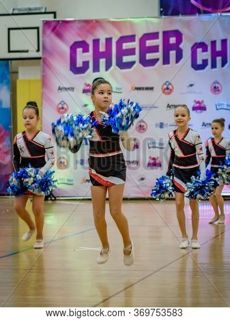 Moscow, Russia - December 22, 2019: Sports Dance Little Girls With Pompons At Cheer Challenge Cheerl