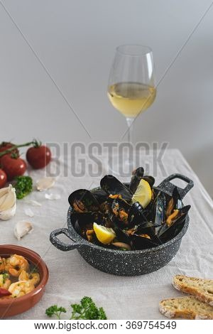 Mediterranean Lunch, Fresh Cooked Mussels With Tomato, Parsley, Lemon, Fresh Bread And White Wine