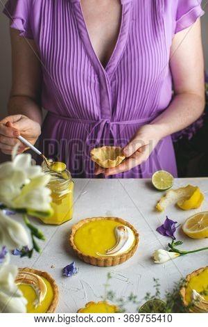 Female Hands Holding Lemon Meringue Tart, Copy Space