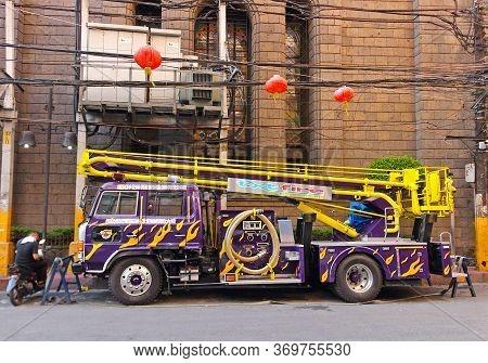 Manila, Philippines - September 24, 2018: Purple Fire Truck With Stairs In Binondo District, Manila,