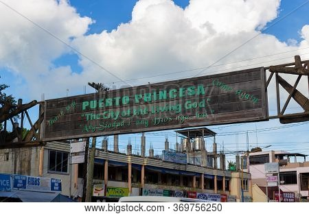 Puerto Princesa, Palawan, Philippines - September 26, 2018: Wooden Welcome Banner Above Road. The In