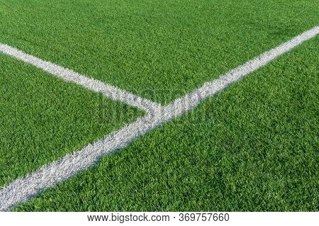 Green Grass And White Border Lines On Football Ground. Soccer Field On Artificial Turf. Artificial G