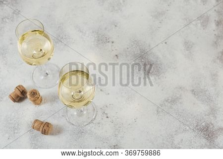 White Wine On Light Grey Background. Two Wineglasses Of Vino Verde. Seasonal Holidays Concept.