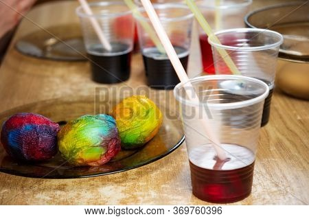 Easter Eggs And Colored Liquid Paints On The Table For Children Using Dye And Painting On White Boil