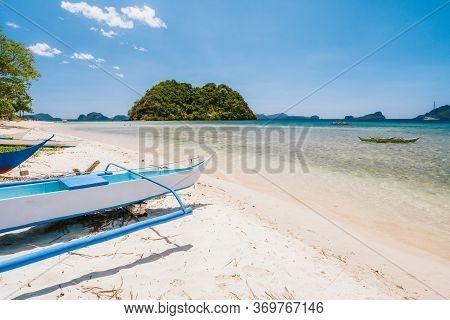 Fisher Boat At Las Sandy Cabanas Beach, El Nido, Palawan, Philippines