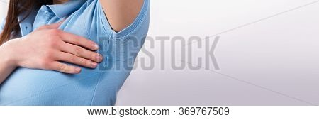 Armpit Sweat And Hyperhidrosis. Sweating Woman Arm