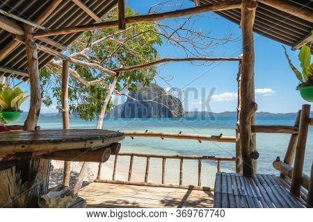 Beautiful Las Cabanas Beach. Veranda Made Entirely Of Wood. El Nido, Palawan, Philippines