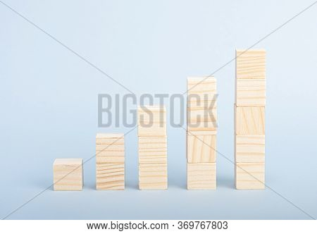 Wooden Blocks N The Form Of A Graphic. Growth Concept. Business And Finance