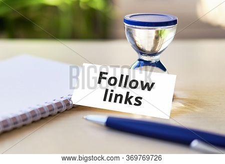 Follow Links Business Seo Concept Text On A Whitfollow Links E Notebook And Hourglass Clock, Blue Pe
