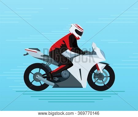 Motorcyclist In A Protective Suit And Helmet Rides A Sports Bike. Adventure Touring Vehicle With A B