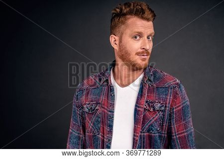 Headshot Of Intrigued Good-looking Ginger Male With Bristle In Blue Shirt Turning At Camera With Imp