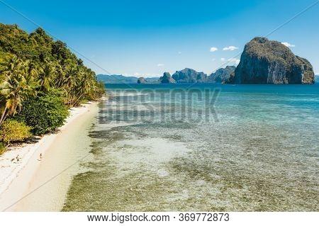 Aerial View Of Tropical Las Cabanas Beach In El Nido, Palawan, Philippines